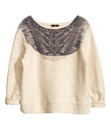 Jumper with lace and a print